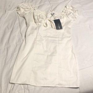 white fashion nova dress.